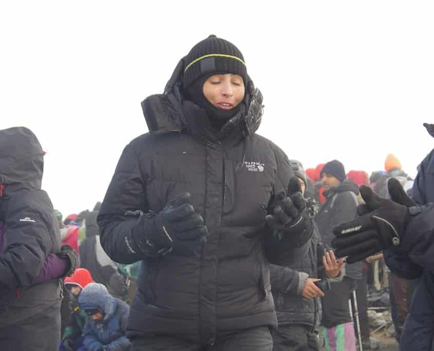 Emma on the summit of Mt Kilimanjaro reflecting on the adventure journey