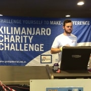 Mitchell Morley running on a treadmill to raise money for charity
