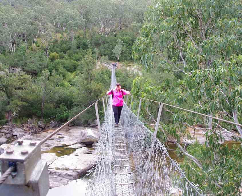 Walk across Botwtells swing bridge on the Six Foot Track Blue Mountains Walk
