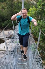Mark Henderson is walking over the famous Bowtells Swing Bridge on the historic Six Foot Track in the Blue Mountains.