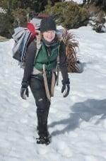 Tracey Jordan trekking through the snow on Peak Potential Adventures winter Overland Track trek through the Tasmanian Central Highlands.