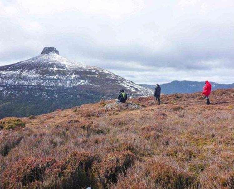 The team sitting below Mt Doris on the Overland Track in Tasmania
