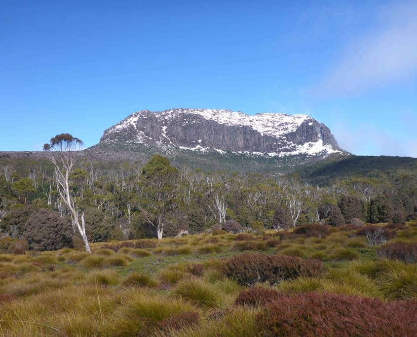 There is usually snow on the mountains when trekking the Overland Track in winter