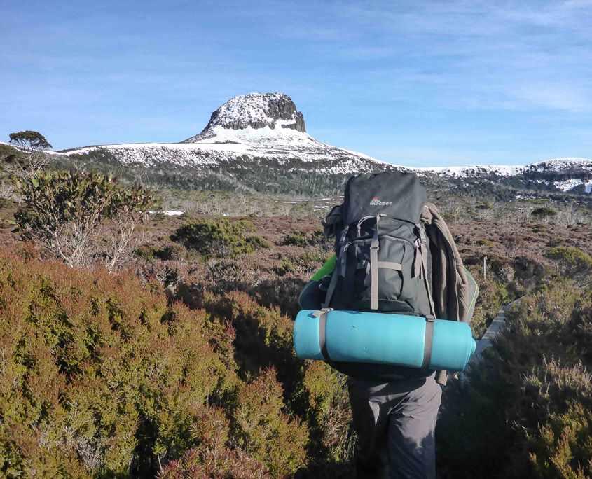 The team trekking towards Barn Bluff on the Overland Track in Tasmania