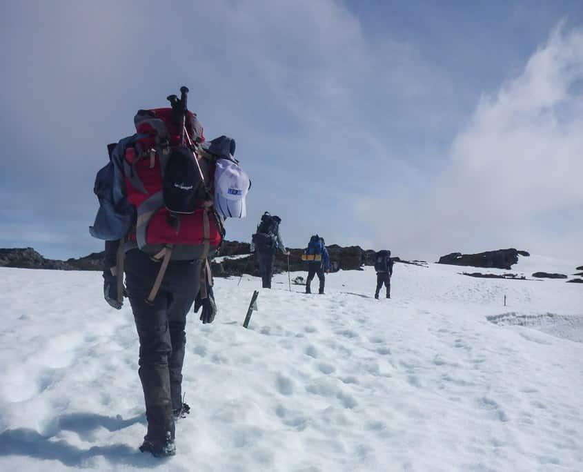 Trekking across the Cradle Mountain Plateau on the Overland Track winter trek