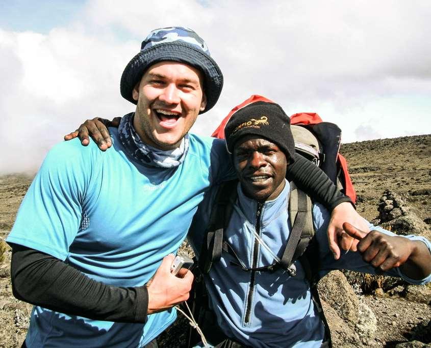 Luke climbing Mount Kilimanjaro with his guide Mandy