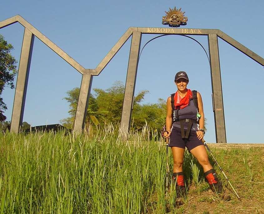 Nikki George standing at Owers Corner on the Kokoda Track